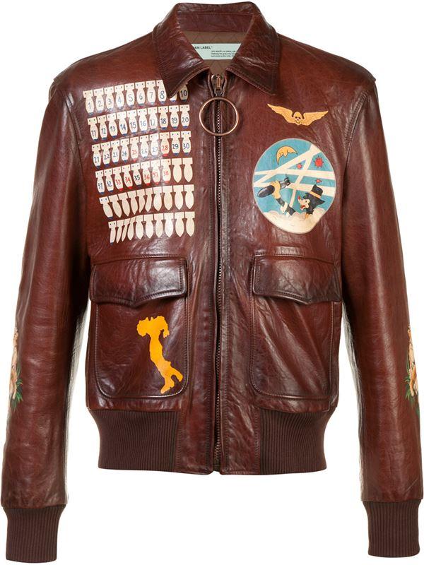 коричнево-рыжая кожаная куртка с аппликациями