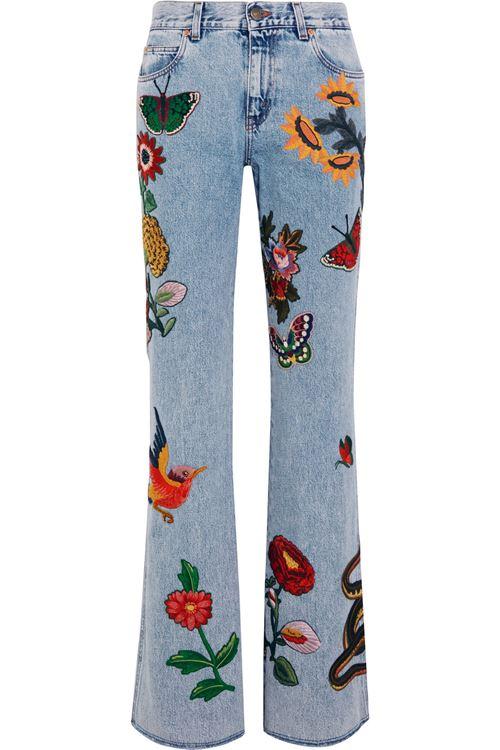 джинсы клеш с аппликациями
