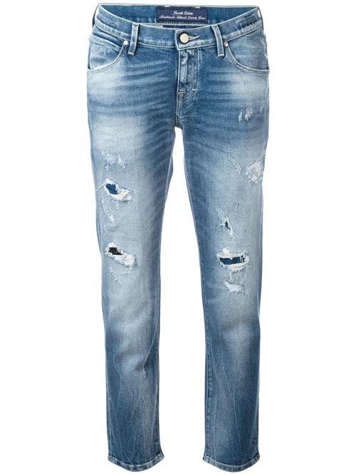 протертые рваные джинсы