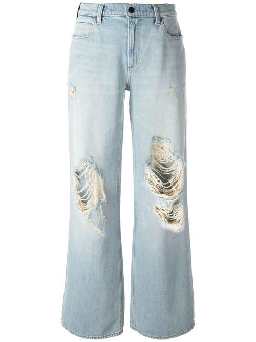 голубые широкие рваные джинсы