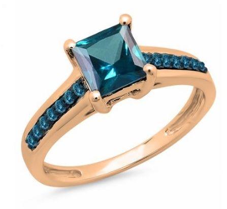 помолвочное кольцо из розового золота с топазами