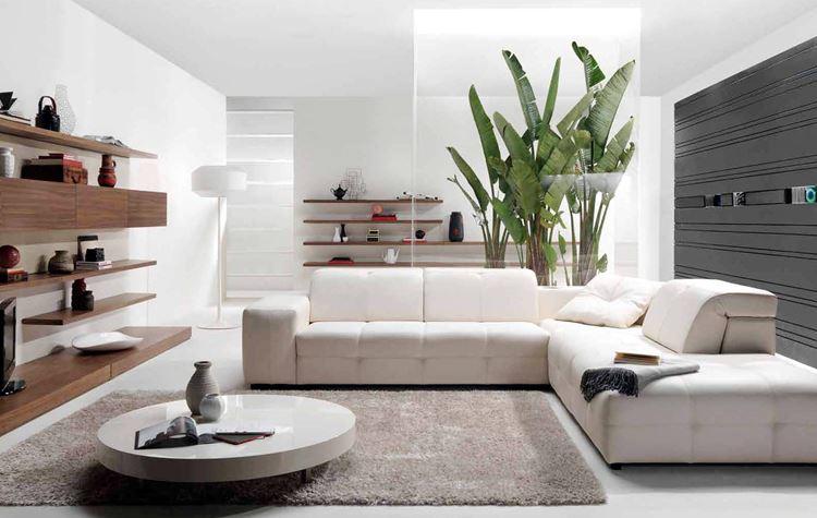 Белый диван в интерьере: бело-серая квартира-студия с большим кожаным угловым диваном