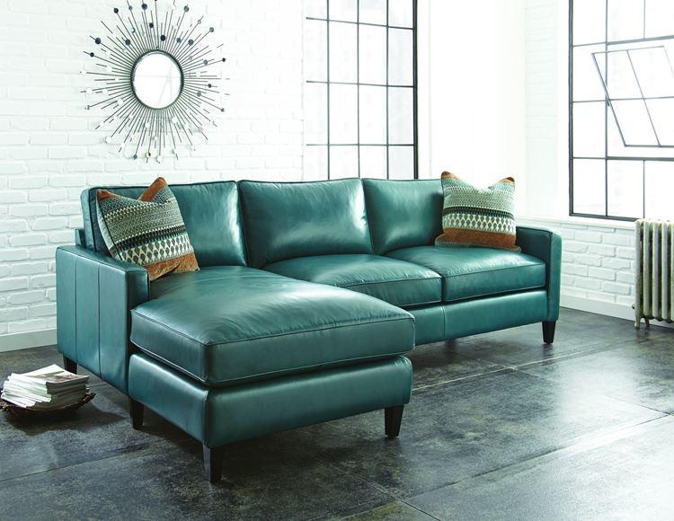 Бирюзовый диван в интерьере: кожаный диван тёмного оттенка морской волны