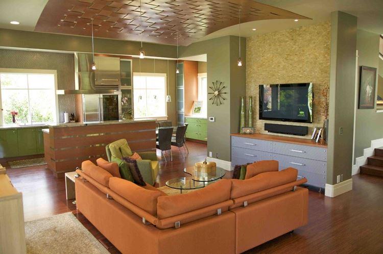 Оранжевый диван в интерьере: гостиная в тёпло-зелёных тонах с угловым диваном