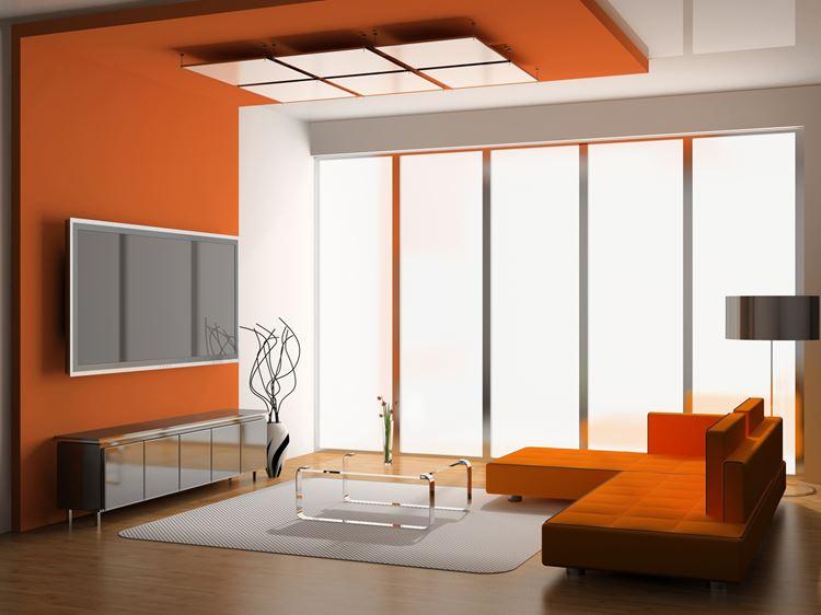 Оранжевый диван в интерьере: гостиная в ярких оранжевых тонах с диваном в стиле конструктивизм